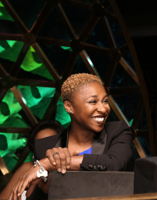 A smile of satisfaction and reflection from Cynthia Erivo.